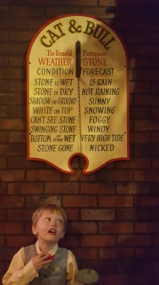 Checking out the weather report at Dickens fair